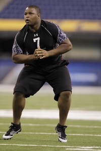 Texas Christian offensive lineman Marcus Cannon runs a drill at the NFL football scouting combine in Indianapolis, Saturday, Feb. 26, 2011. (AP Photo/Michael Conroy)