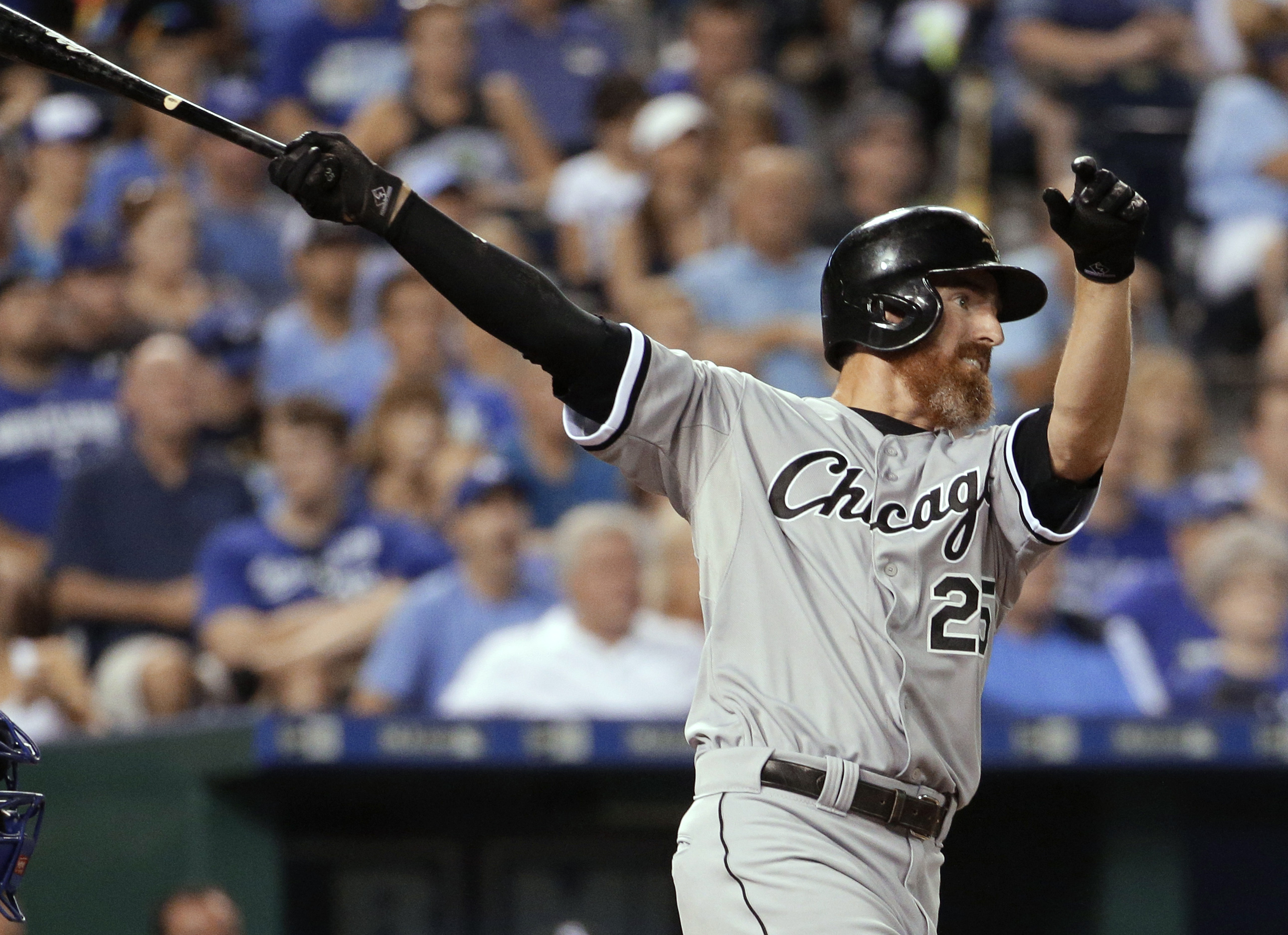Chicago White Sox's Adam LaRoche follows through on a solo home run during the ninth inning of a baseball game against the Kansas City Royals Friday, Aug. 7, 2015, in Kansas City, Mo. The Royals won 3-2. (AP Photo/Charlie Riedel)