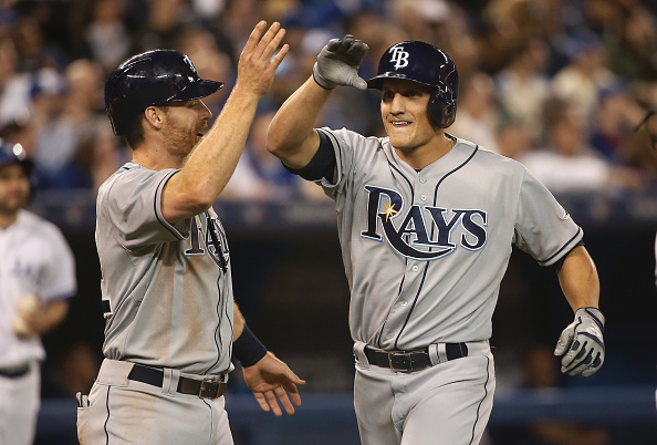 TORONTO, CANADA - APRIL 15: Mike Mahtook of the Tampa Bay Rays is congratulated by Logan Forsythe #11 after hitting a two-run home run in the sixth inning during an MLB game against the Tampa Bay Rays on April 15, 2015 at Rogers Centre in Toronto, Ontario, Canada. All uniformed team members are wearing jersey number 42 in honor of Jackie Robinson Day. (Photo by Tom Szczerbowski/Getty Images)