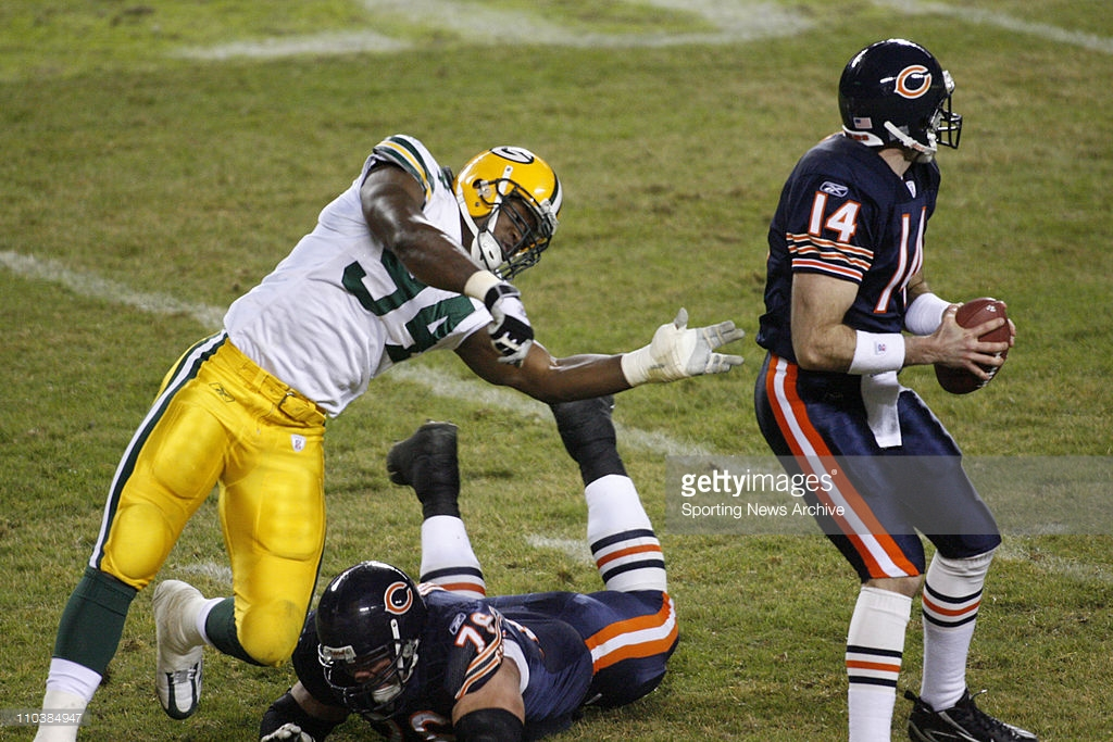 Green Bay Packers Kabeer Gbaja-Biamila against Chicago Bears Brian Griese, John Tait at Soldier Field in Chicago, Ill. on Dec. 31, 2006. The Packers won 26-7. MANDATORY CREDIT:(Jay Drowns/Sporting News) DIGITAL PHOTOGRAPH