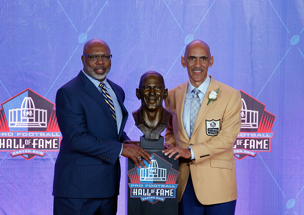 CANTON, OH - AUGUST 06:  Tony Dungy (R), former NFL player and head coach, poses next to his bronze bust with friend and former NFL player, presenter Donnie Shell (L), during the NFL Hall of Fame Enshrinement Ceremony at the Tom Benson Hall of Fame Stadium on August 6, 2016 in Canton, Ohio.  (Photo by Joe Robbins/Getty Images)